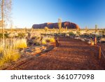 Small photo of Majestic Uluru and the footpath to the viewing platform at sunrise on a clear winter's morning in the Northern Territory, Australia
