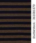 Small photo of Black and gold striped background. Asymmetric vertical stripes pattern on fabric.