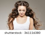 model with long hair. waves... | Shutterstock . vector #361116380