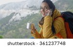 hiker talking on phone during a ... | Shutterstock . vector #361237748