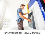 man using atm to withdraw cash | Shutterstock . vector #361250489
