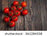 Fresh Cherry Tomatoes On Wood...