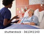 Nurse Talking To Senior Female...