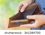 empty wallet  no money  in man... | Shutterstock . vector #361384700