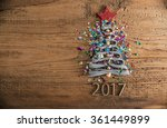 Small photo of Sigh symbol Christmas Tree from a lot colorful confetti, lace and red star toy on old retro vintage style wooden texture background Empty copy space for inscription Idea of merry new year 2017 holiday