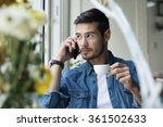 handsome man in jeans talking... | Shutterstock . vector #361502633