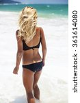 girl on the beach in a swimsuit.... | Shutterstock . vector #361614080