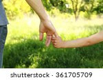 a the parent holds the hand of... | Shutterstock . vector #361705709