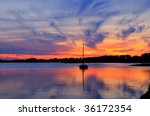 Sunset And Sailboat In Martha'...