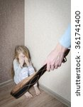 Small photo of Child Abuse with abusive parent father, girl standing in the corner punished