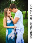 pregnant couple on the park | Shutterstock . vector #361745114