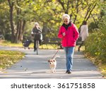 old woman with a dog in autumn... | Shutterstock . vector #361751858