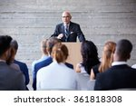 Small photo of Senior Businessman Addressing Delegates At Conference