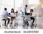 manager helping staff in busy... | Shutterstock . vector #361843580