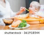 mom feeds the baby soup.... | Shutterstock . vector #361918544