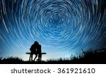two people watching the stars