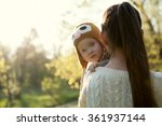 baby on mother's arms | Shutterstock . vector #361937144