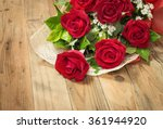 Stock photo red roses bouquet put on wooden table for valentine s day 361944920