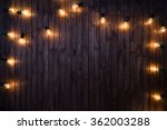 light bulbs on dark wooden... | Shutterstock . vector #362003288