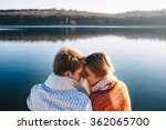 Stock photo happy young couple in love wearing warm clothes cuddling at a lake 362065700