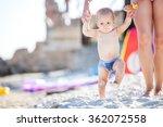Baby Boy Walking Along Beach...