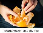 Woman Hand Peeling Ripe Sweet...
