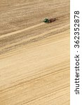 Small photo of American Falls, Idaho, USA Apr. 17, 2015 A aerial view of a tractor plowing a farm field in preparation for spring planting.