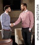 Business Handshake Between Two...