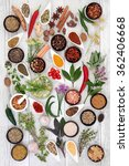 Small photo of Large herb food seasoning sampler over distressed white wood background.