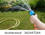 Woman's Hand With Garden Hose...