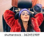 Small photo of Young hipster woman relaxing in cabrio auto after long trip - Trendy girl sleeping in boyfriend's car - Fashion and vintage concepts - Soft brown filtered look