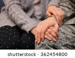 Small photo of Military couple holding hands, married caucasian, Air Force.