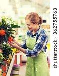 happy woman touching mandarin... | Shutterstock . vector #362755763