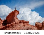 Man On Top Of A Rock Formation...