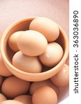 Small photo of fress eggs in clay bowl