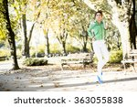 young woman running in the park | Shutterstock . vector #363055838