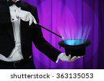 Midsection Of Magician Holding...
