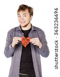 smiling man holding a red heart ...   Shutterstock . vector #363236696