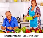 senior couple cooking at... | Shutterstock . vector #363245309