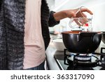 young woman cooking in her... | Shutterstock . vector #363317090