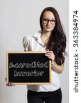 Small photo of Accredited Investor - Young businesswoman holding chalkboard - vertical image