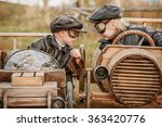Small photo of Two boy racer at the start on makeshift wooden machines compete on the rural outskirts
