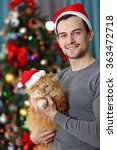 Young Man With Fluffy Red Cat...
