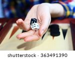 Female Hand Throwing Dice On A...