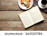 Open Book And Snack On Wooden...