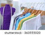 clothes hang on a shelf in ... | Shutterstock . vector #363555020