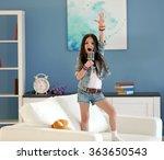 Artistic Little Girl Singing In ...