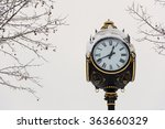 old clock covered with snow in... | Shutterstock . vector #363660329