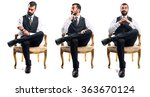businessman sitting on armchair | Shutterstock . vector #363670124