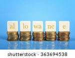 Small photo of Word ALLOWANCE on stacked coins, business conceptual.
